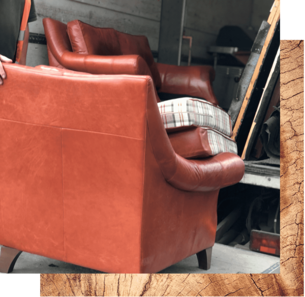 Streetwise large household unwanted items collection. An image showing an old red leather sofa being placed in to the back of a removal van with other bulky waste materials such as fencing