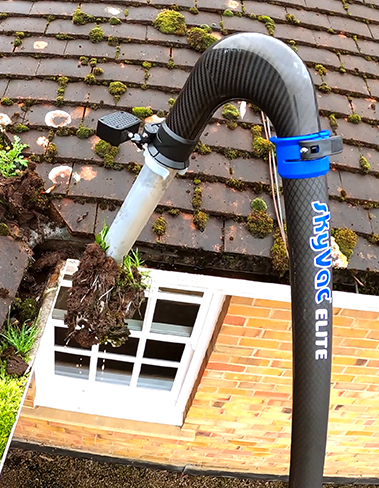 skyVac cleaning gutter