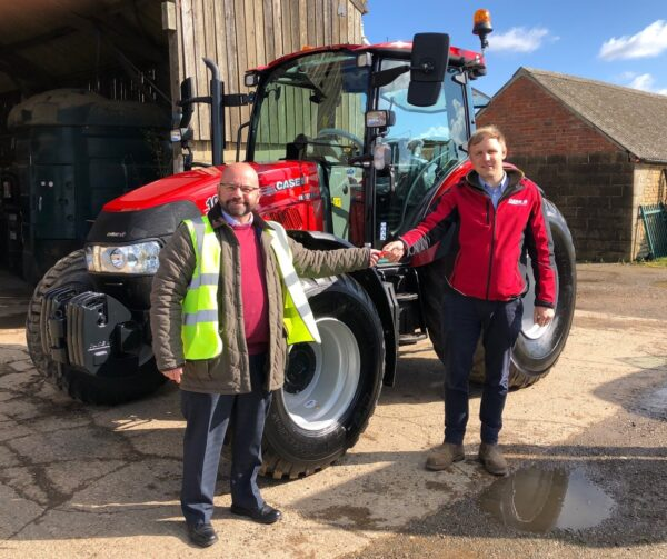 Streetwise-Managing-Director-Nigel-Carter-Andrew-Channing-Shermans-hands-keys-to new red tractor