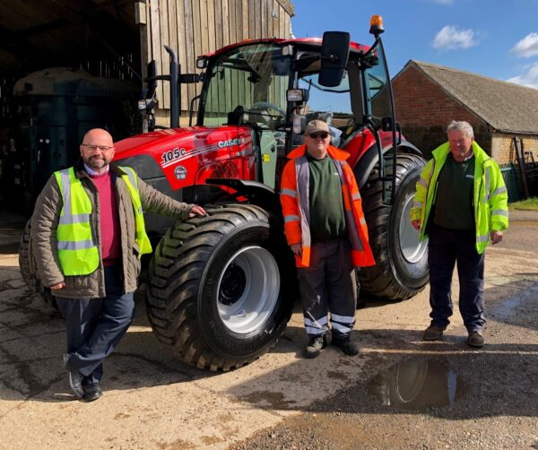 Streetwise Managing Director, Nigel Carter with Streetwise operatives taking delivery of new red tractor